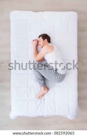 Handsome man sleeping in bed  - stock photo