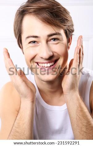 Handsome man, smile, joy, emotions. Portrait of a handsome attractive boy.  - stock photo