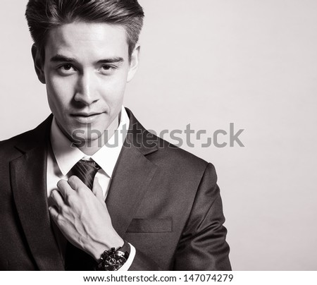 Handsome man smiling (black and white portrait) - stock photo