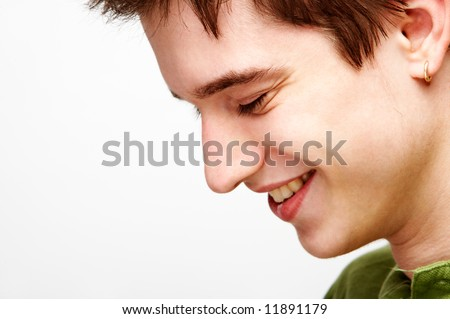 handsome man smiling. very shallow DOF - stock photo