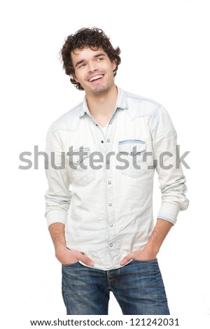 Handsome man smiling. Young male model has hands in his pocket and looking to the side. Isolated on white background. - stock photo