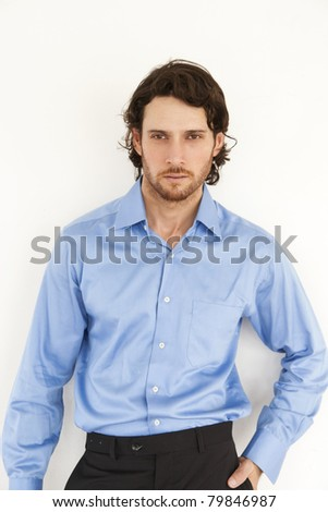 handsome man standing against the wall - stock photo