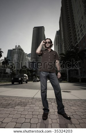 Handsome man standing in the street in a city scene