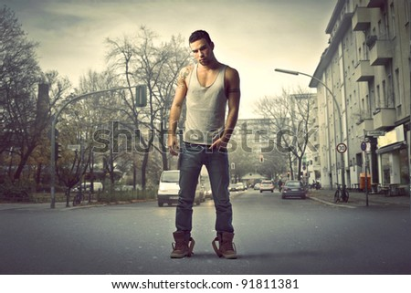 Handsome man standing on a city street - stock photo