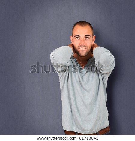 Handsome man standing on blue background - stock photo