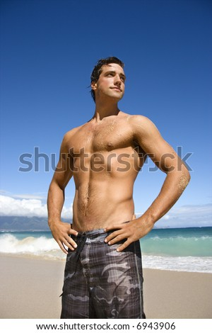Handsome man standing on Maui, Hawaii beach.