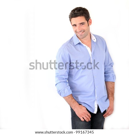 Handsome man standing on white background - stock photo