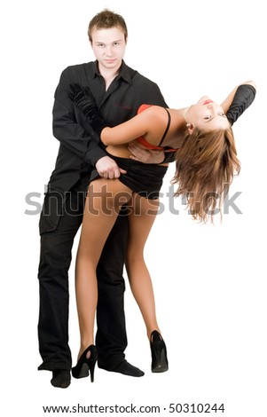 Handsome man stripping attractive woman. Isolated on white - stock photo