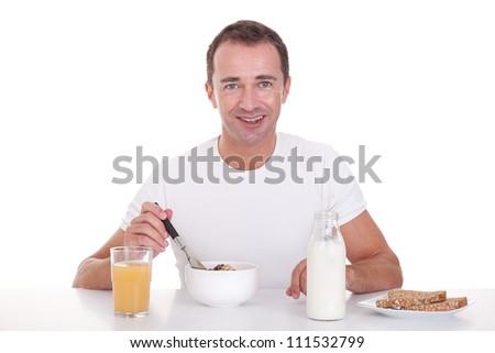 handsome man taking breakfast, isolated on white, studio shot - stock photo
