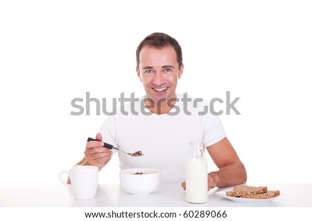 handsome man taking breakfast, isolated on white, studio shot