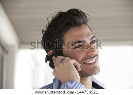 handsome man talking on phone and smiling