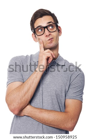 Handsome man thinking and looking at copy space  - stock photo