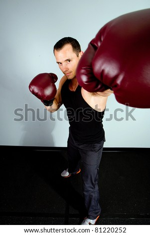 Handsome Man training as a boxer - stock photo