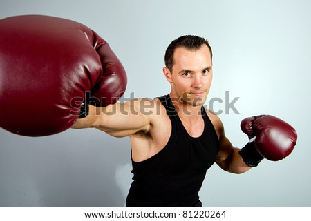 Handsome Man training as a boxer