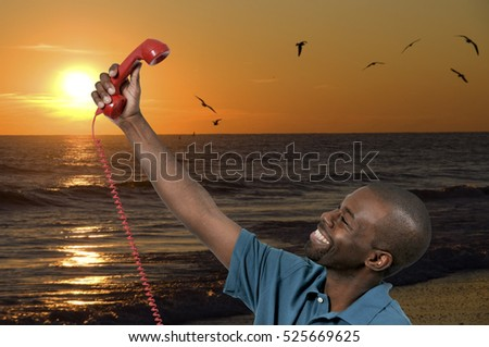 Handsome man trying to take a selfie with a rotary phone