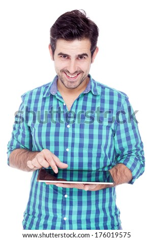 Handsome man using a tablet computer, isolated over a white background - stock photo