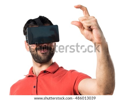 Handsome man using VR glassesa and holding something