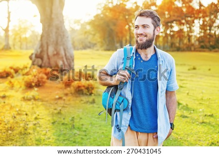 handsome man walking in a park - stock photo