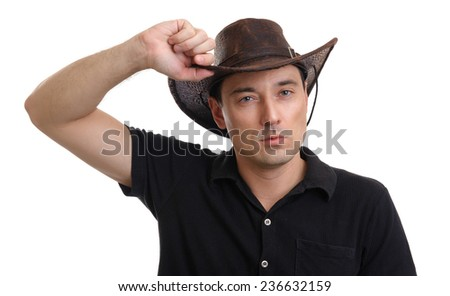 handsome man wearing cowboy hat. Isolated over white - stock photo