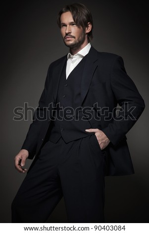 Handsome man wearing dark suit - stock photo