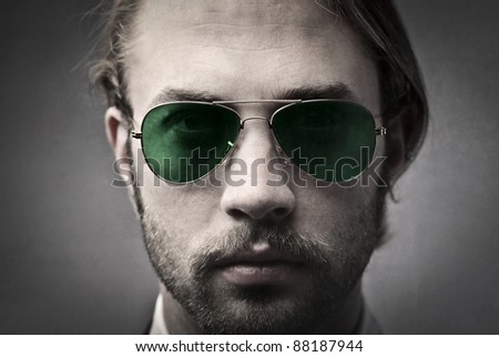 Handsome man wearing fashion sunglasses
