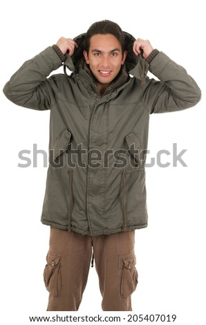 handsome man wearing jacket and putting hoodie on isolated over white - stock photo