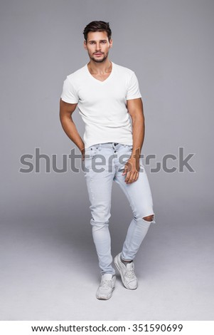 Handsome man wearing jeans and white t-shirt - stock photo