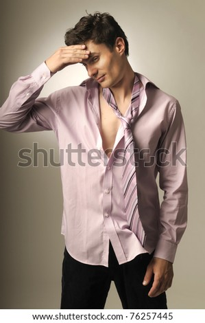 Handsome man wearing shirt and tie having an headache - stock photo