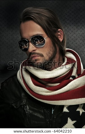 Handsome man wearing sunglasses - stock photo