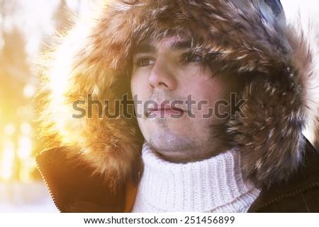 Handsome man winter portrait - stock photo