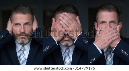 handsome man with beard and in suit and tie posing as the three wise monkeys - stock photo