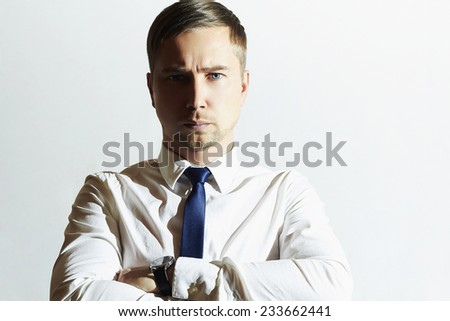 handsome man with blue eyes. Businessman. Young man in tie. Business concept.Serious - stock photo