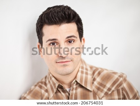 Handsome man with confident serious expression closeup  - stock photo