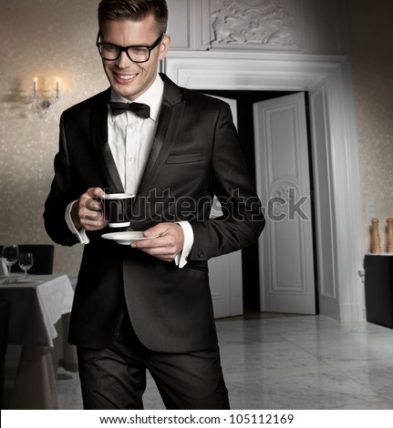 Handsome man with cup of coffee - stock photo