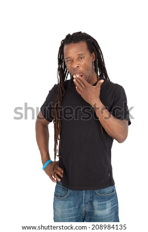 Handsome man with dreadlocks doing different expressions in different sets of clothes: yawning
