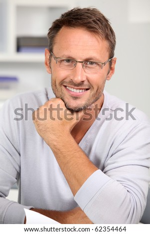 Handsome man with eyeglasses on - stock photo