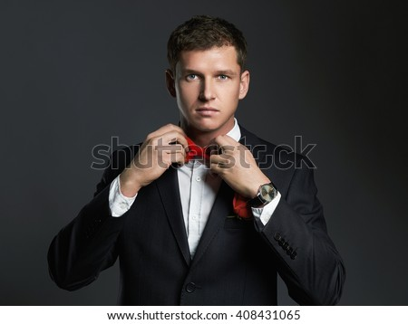 handsome man with flower preparing for a date. young groom man in suit.elegant boy without face - stock photo