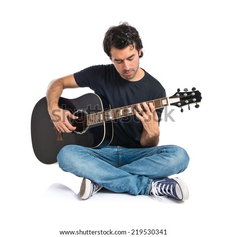 Handsome man with guitar over white background - stock photo