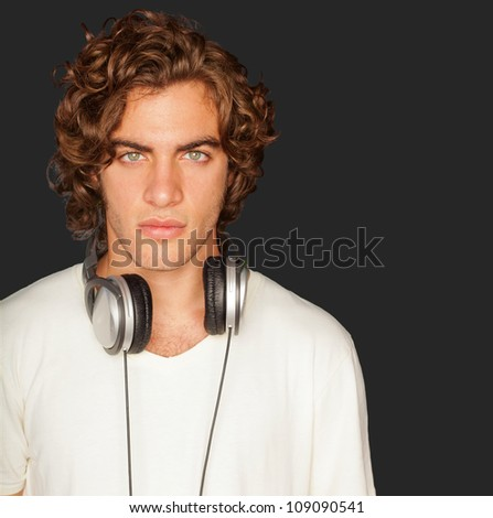 Handsome Man With Headphones Isolated On Black Background - stock photo