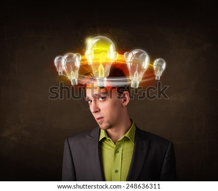 Handsome man with light bulbs circleing around his head - stock photo