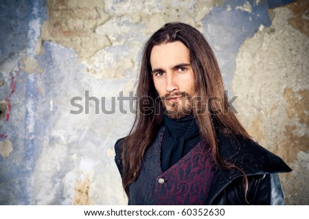 Handsome man with long hair - stock photo