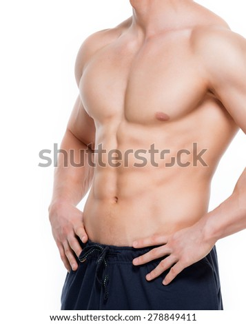Handsome man with perfect muscular torso  - isolated on white background. - stock photo
