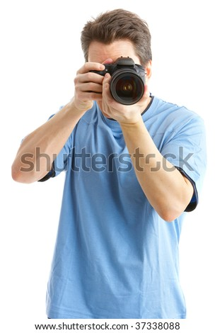 Handsome man with photo camera. Isolated over white background