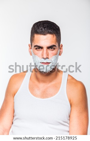 handsome man with shaving cream on his face, on white
