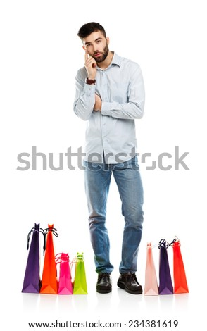 Handsome man with shopping bags. Christmas and holidays concept - stock photo