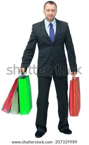 handsome man with shopping bags over white  - stock photo