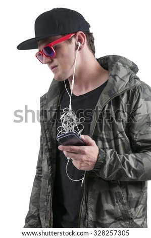 Handsome man with tangled headphones in a twisted mess - stock photo