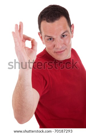 handsome man with thumb raised as a sign of ok, isolated on white background. studio shot - stock photo