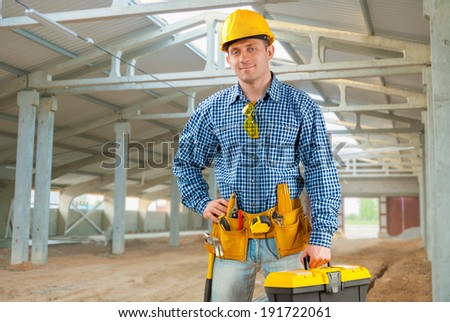 handsome man with working tools