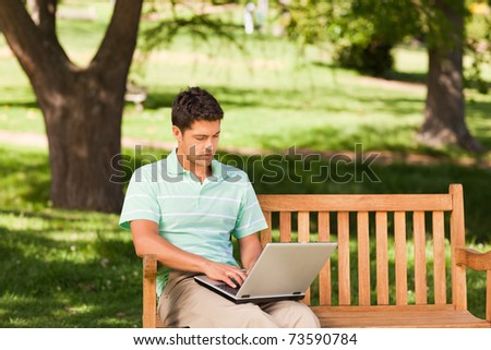 Handsome man working on his laptop - stock photo